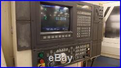 Cnc Lathe Okuma Lb 15ii 8 Chuck, Tool Blks, Chip Conveyor, Osp7000l, Tailstock